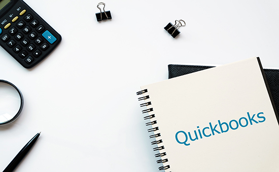 Quickbooks notebook and calculator